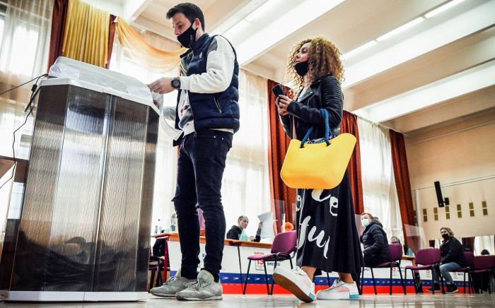 People cast their ballots at a polling station during parliamentary and local elections in Moscow on 18 September 2021. Picture: AFP