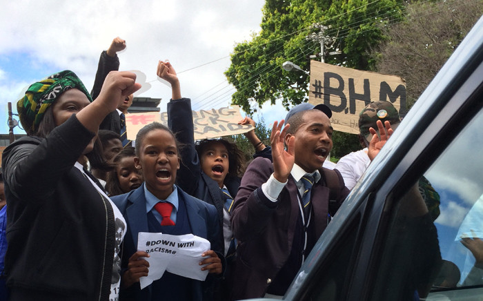 FILE: Protesters preventing a teachers car from leaving the Sans Souci Schools premises. Picture: Anthony Molyneaux/EWN.