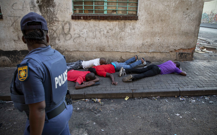 Suspects detained in Jeppestown outside Mai Mai market. Picture: Thomas Holder/EWN.