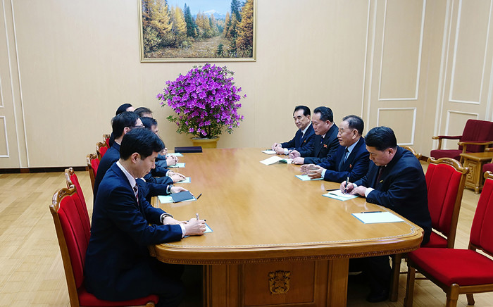 This handout photograph taken and released by the presidential Blue House on 5 March 2018 shows a South Korean delegation (L row), who travelled as envoys of the South's President Moon Jae-in, talking with General Kim Yong Chol (2nd R), who is in charge of inter-Korean affairs for North Korea's ruling Workers' Party, during their meeting in Pyongyang. Picture: AFP