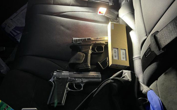 Police seized two hijacked luxury cars, 10 firearms of varying calibres and multiple rounds of ammunition during a raid at a premises in Sharpeville. Picture: @SAPoliceService/Twitter