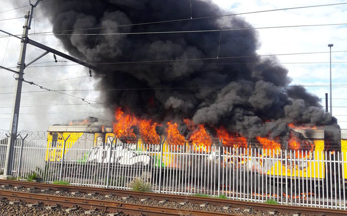 Train on fire at Retreat Station in Cape Town on 07 August, 2016. Picture: Twitter @CRW2310.