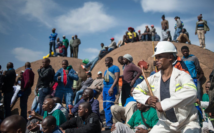 Miners gather during commemorations to mark the fourth anniversary of the Marikana Massacre in Rustenburg on August 16, 2016. Picture: AFP