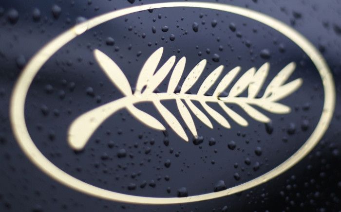 Rain drops on the Palm logo on an official car during the Cannes Film Festival. Picture: AFP