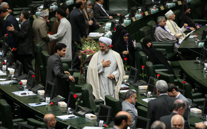 Iranian MPs attend the opening session of Iran's new parliament in Tehran on May 27, 2012. Picture: AFP.