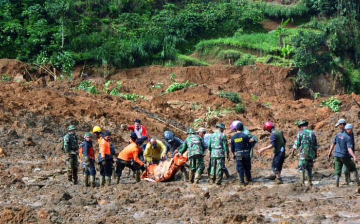FILE: A rescue team searches for survivors and remove bodies after a landslide at Jemblung village in Banjarnegara, Central Java province, on 13 December, 2014. Picture: AFP.