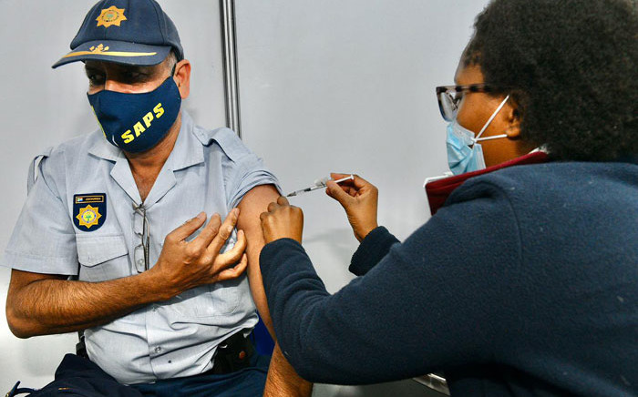 A police officer gets his COVID-19 vaccine at the Orlando Stadium in Soweto on 5 July 2021. Picture: @GautengProvince/Twitter