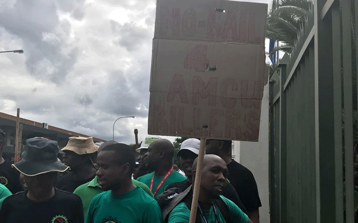 A poster reads 'no bail for Amcu killers' as six men appear at the at the Brits Magistrates Court on 21 February 2018. Picture: Masechaba Sefularo/EWN.