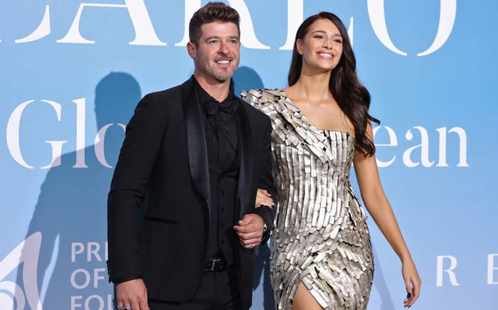 FILE: US singer Robin Thicke (L) and his partner US model April Love Geary pose upon their arrival at the 2nd Monte-Carlo Gala for the Global Ocean 2018 held in Monaco on 26 September 2018. Picture: AFP
