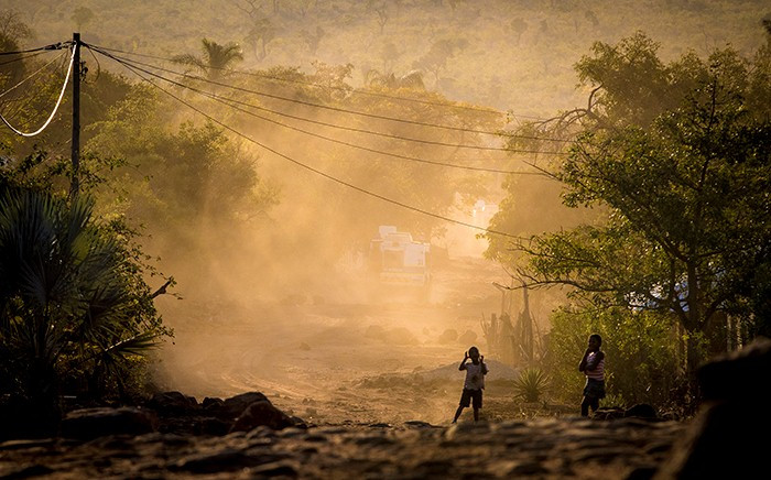 As an Nyala patrols a section of Vuwani, kids play in the recently barricaded street behind it. Picture: Thomas Holder/EWN