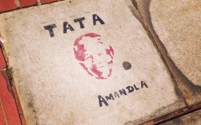 Nelson Mandela's face painted on the floor in Vilakazi street in Soweto. Picture: Gia Nicolaides/EWN.