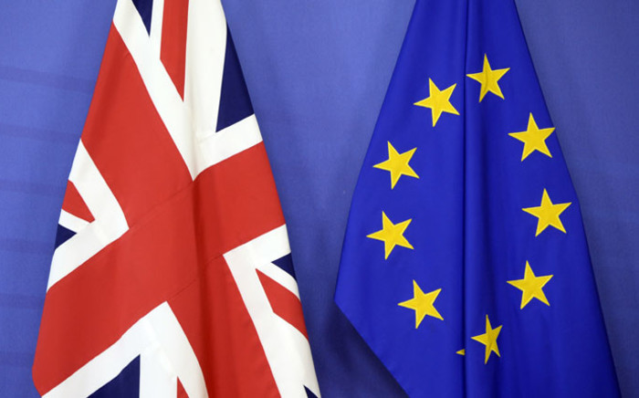 FILE: The British flag (L) stands next to the European Union flag at the European Union Commission headquarter in Brussels, 17 July 2017. Picture: AFP