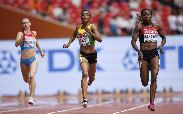 """Jamaica's Christine Day (C) and Kenya's Joyce Zakary compete in the heats of the women's 400 metres athletics event at the 2015 IAAF World Championships at the """"Bird's Nest"""" National Stadium in Beijing on 24 August, 2015. Picture: AFP."""