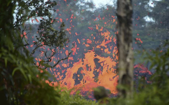 Lava is seen coming from a fissure in Leilani Estates subdivision on Hawaii's Big Island on 4 May 2018. Picture: AFP.