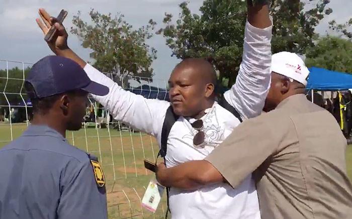 Sam Mkokeli manhandled by security at Nasrec. Picture: ShoeShoe Qhu/Kaya FM