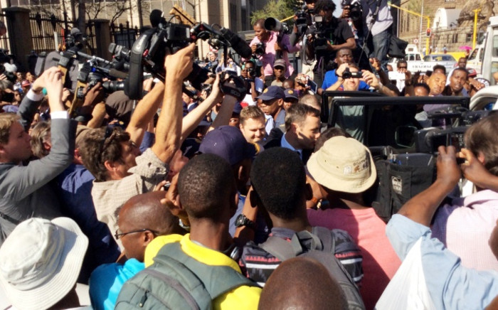 Cellphone image showing paralympian Oscar Pistorius leaving the High Court in Pretoria on Thursday, 11 September 2014. Picture: Sapa.