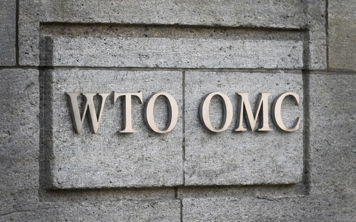 FILE: A sign of the World Trade Organisation (WTO) is seen on 2 October 2018 at their headquarters in Geneva. Picture: AFP.