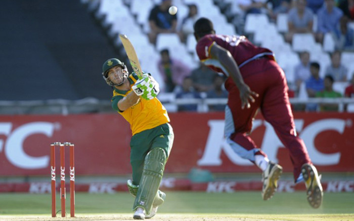 South Africas batsman Francois du Plessis (L) plays a shot as West Indies bowler Jason Holder bowls during the first Twenty20 cricket match between South Africa and the West Indies at Newlands cricket stadium in Cape Town on January 9, 2015. Picture: AFP