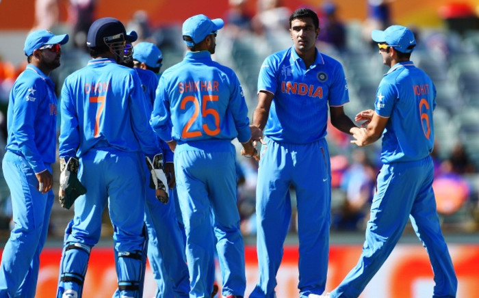 India's Ravichandran Ashwin (2nd-R) celebrates with teammates after taking the wicket of United Arab Emirates batsman K. Karate during the 2015 Cricket World Cup Pool B match between the UAE and India in Perth on 28 February 2015. Picture: AFP.