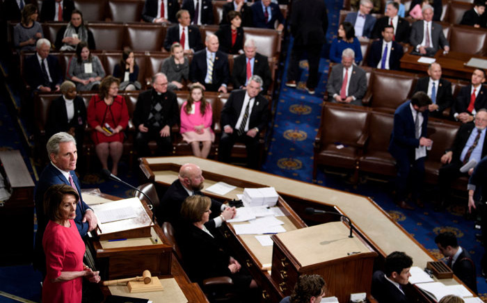 Speaker of the House Nancy Pelosi (D-CA) listens while House Minority Leader Kevin McCarthy (R-CA) addresses the House of Representatives during the opening session of the 116th Congress on Capitol Hill on 3 January 2019 in Washington, DC. Picture: AFP