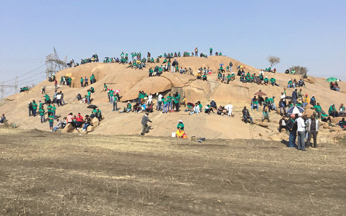 Miners sit at the 'koppie' in Marikana ahead of a programme to commemorate the Marikana massacre, on 16 August 2018. Picture: Pelane Phakgadi/EWN