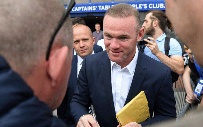 Everton's new signing, English striker Wayne Rooney signs autographs for supporters after giving a press conference at Goodison Park in Liverpool on 10 July 2017. Picture: AFP.