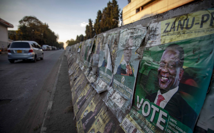 An election campaign poster on a street in Harare, Zimbabwe. Picture: Thomas Holder/EWN.