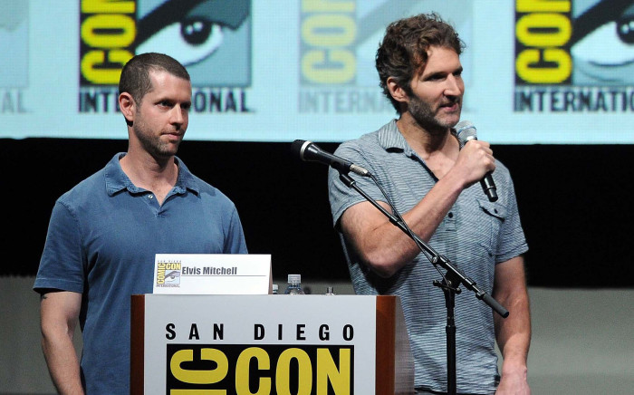 """UNITED STATES, SAN DIEGO : SAN DIEGO, CA - JULY 19: Producers D.B. Weiss (L) and David Benioff speak onstage during the """"Game Of Thrones"""" panel during Comic-Con International 2013 at San Diego Convention Center on July 19, 2013 in San Diego, California. Kevin Winter/Getty Images/AFP"""