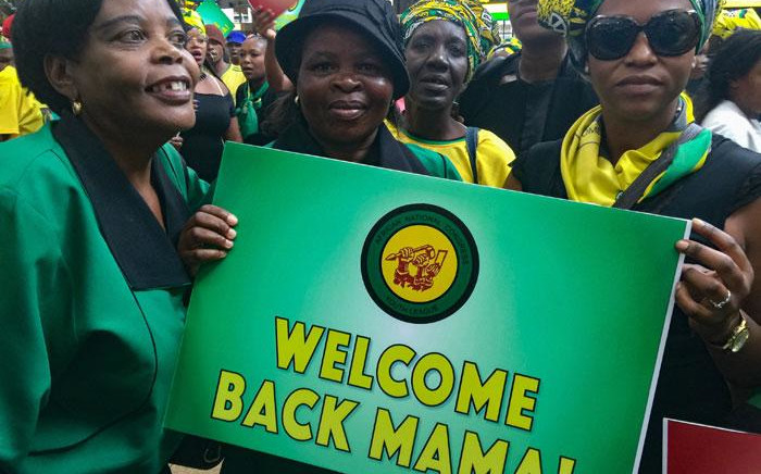 Members of the ANC sing and dance at the international arrivals terminal at OR Tambo International airport ahead of the arrival of former AU head Nkosazana Dlamini-Zuma. Picture: Reinart Toerien/EWN
