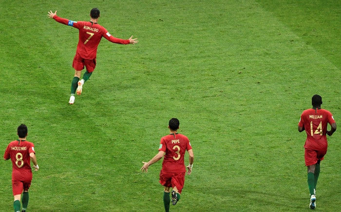 Portugal's forward Cristiano Ronaldo (7) celebrates after scoring his third goal during the Russia 2018 World Cup Group B football match between Portugal and Spain at the Fisht Stadium in Sochi on 15 June 2018.Picture: AFP