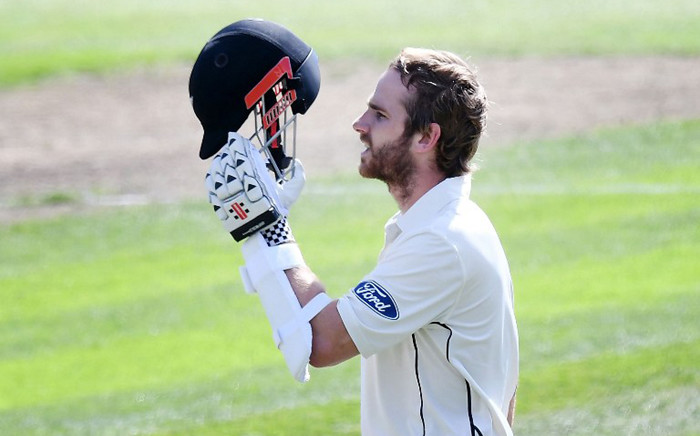 New Zealand's captain Kane Williamson celebrates 100 runs during day three of the 1st International cricket test match between New Zealand and South Africa at the University Oval in Dunedin on 10 March, 2017. Picture: AFP.