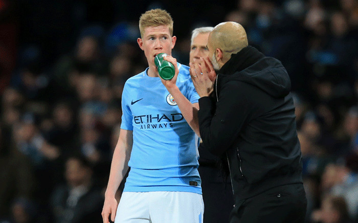 FILE: Manchester City midfielder Kevin De Bruyne (L) takes a drink as Manchester City's manager Pep Guardiola (R) gives instructions during the English Premier League football match on 31 January 2018. Picture: AFP