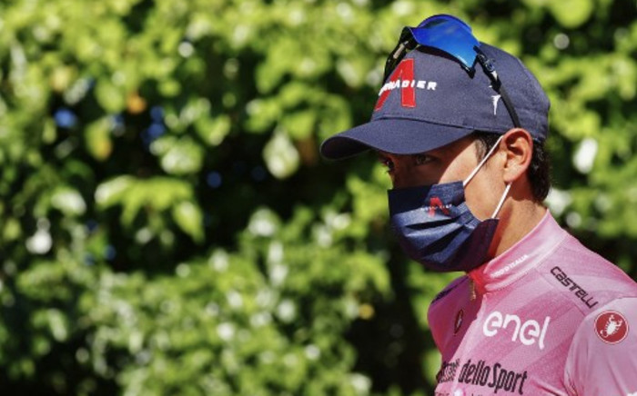 Team Ineos rider Colombia's Egan Bernal walks down the podium after celebrating his overall leader's pink jersey after the tenth stage of the Giro d'Italia 2021 cycling race, 139 km between l'Aquila and Foligno on 17 May 2021. Picture: AFP