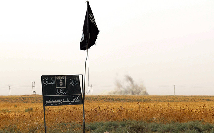 An Islamic State group (IS) flag and banner. Picture: AFP.