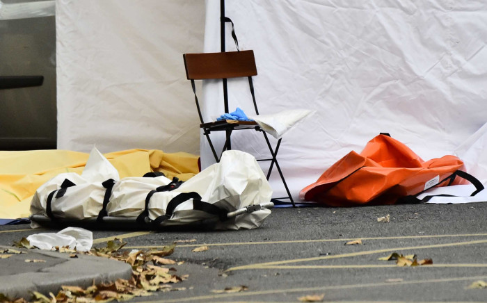 The covered body of a dead person is pictured at the Rue de Charonne in Paris on November 14, 2015, following a series of coordinated attacks in and around Paris late Friday which left more than 120 people dead. Picture: AFP.