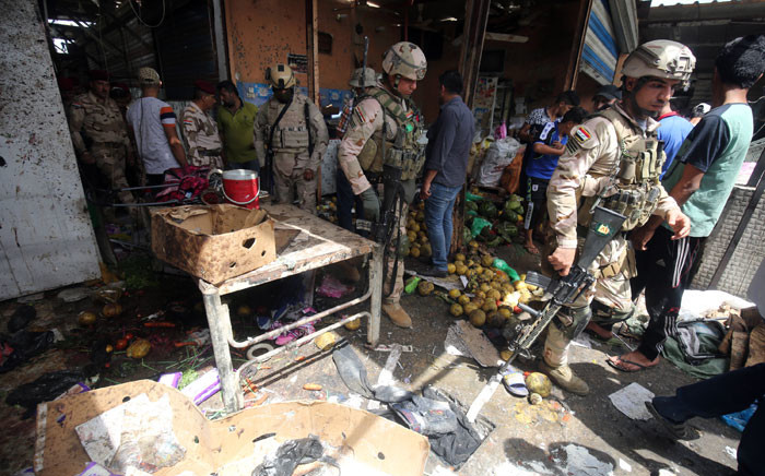 FILE: Iraqi security forces gather at the site of a suicide bombing in the Shaab area in northern Baghdad on 17 May 2016. Picture: Ahmad al-Rubaye/AFP.