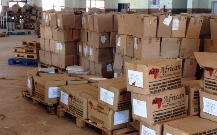 FILE: A photograph taken by the DA leader in Limpopo, Desiree van der Walt, shows boxes abandoned in a hall, apparently full of undelivered textbooks. 3 April 2014. Picture: Supplied.