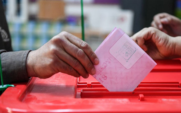 A Tunisian casts his checked ballot in a box as he votes in the first free municipal elections since the 2011 revolution, at a polling station in Ben Arous near the capital Tunis on 6 May 2018. Picture: AFP.