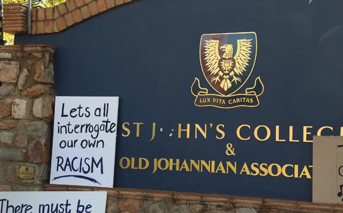 Posters outside St John's College in Johannesburg after a racist teacher was allowed to keep his job on 28 July 2017. Picture: Christa Eybers/EWN
