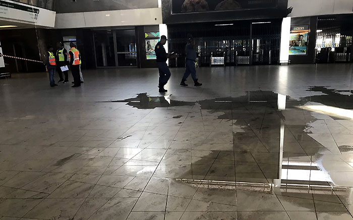 Officials seen at the Cape Town train station on Thursday 28 November after trains were gutted by a fire. Picture: Lauren Isaacs/EWN.