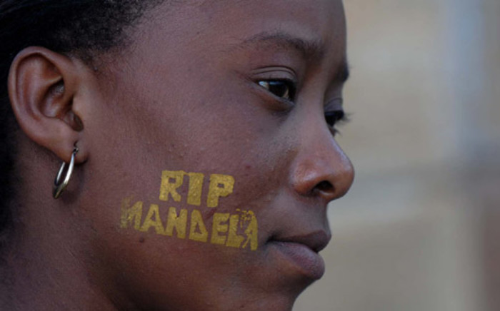 A woman pays tribute to former president Nelson Mandela lying in state on 12 December 2013. Picture: GCIS.