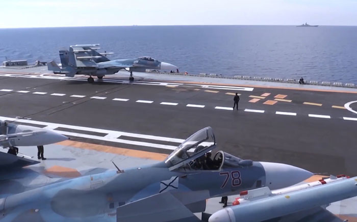 FILE: Jets on the deck of the 'Admiral Kuznetsov' aircraft carrier in the eastern Mediterranean off the Syrian coast.  Picture: AFP