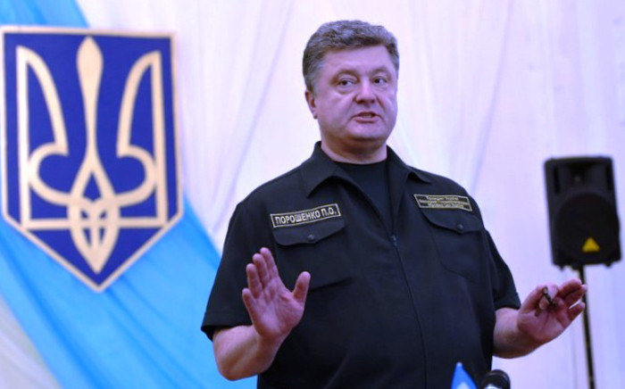 Ukrainian President Petro Poroshenko answers during a press conference in the key southeastern port city of Mariupol, on 8 September 2014. Picture: AFP.