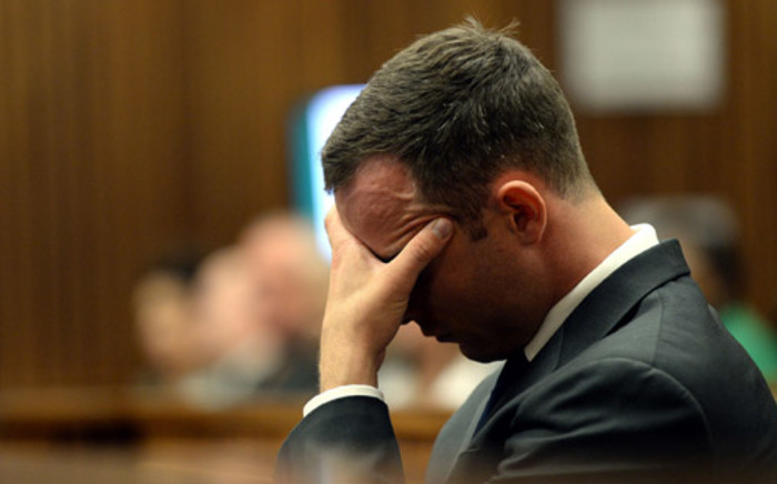 Oscar Pistorius shows signs of fatigue during his murder trial at the high court in Pretoria on 24 March 2014. Picture: Pool.