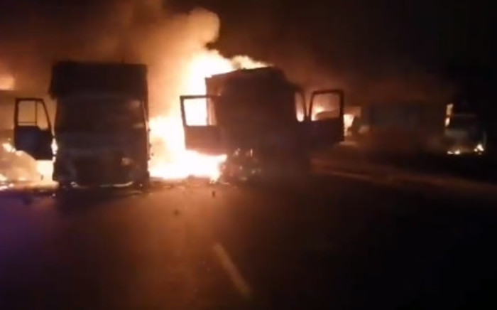 A screengrab of a video showing trucks set alight during protests in KwaZulu-Natal on 9 July 2021 calling for the release of former President Jacob Zuma from jail.