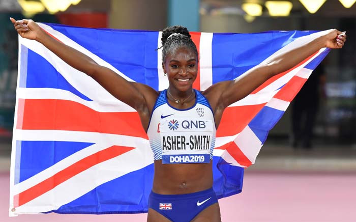 Britain's Dina Asher-Smith celebrates after winning the Women's 200m final at the 2019 IAAF Athletics World Championships at the Khalifa International stadium in Doha on 2 October 2019. Picture: AFP.