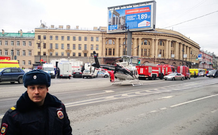 Emergency vehicles and a helicopter at the entrance to Technological Institute metro station in Saint Petersburg on 3 April 2017 after blasts hit the metro system of Russia's second city on Monday. Picture: AFP.