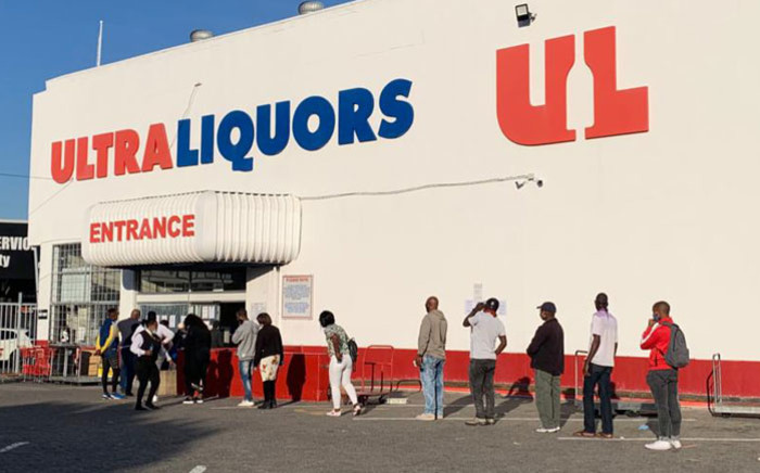 Customers queue outside the Ultra Liquors in Wynberg, Cape Town following the relaxation of alcohol sale restrictions on 1 June 2020. Picture: Kaylynn Palm/EWN