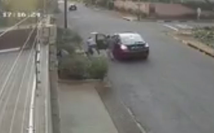 A screengrab of CCTV footage showing a woman being attacked during an attempted robbery in Auckland Park, Johannesburg.