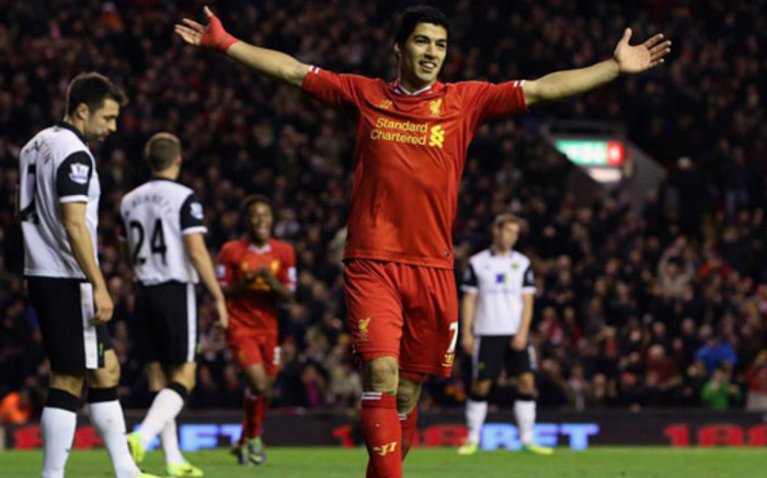 Liverpool striker, Luis Suarez celebrates as they beat Norwich 5-1 at Anfield in the Premier League on 4 December 2013. Picture: Facebook.